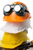 Safety hat and goggles glasses isolated — Stock Photo