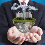 Businessman cover green energy island — Stock Photo #56207415