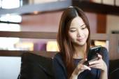 Young Asian girl use mobile phone for search information — Stock Photo