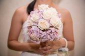 Holding flowers — Stock Photo