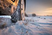 Winter tires in snow — ストック写真