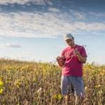Farmer in soybean fields — Stock Photo #82885076