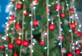 Christmas balls on tree and light decoration bokeh background — Stock Photo