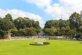Fountain and grass field in Reunification Palace, landmark in Ho Chi Minh City, Vietnam — Stock Photo