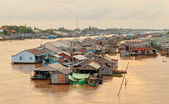 Floating village and selling motorboat on Bassac river in Chau Doc town, Vietnam — Stock Photo