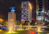 Night view of the Me Linh square downtown Hochiminh city with luxury office buildings and five star hotel, near Saigon riverside — Stock Photo