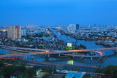Saigon twinlight , Aerial view of Ho Chi Minh city at blue hour view from the high, Traffic around Nguyen Van Cu Bridge — Stock Photo