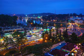 Dalat city at night from high above with hotels, da lat market and road. — Stock Photo