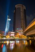 Ho Chi Minh city colorful night with laser lighting on at the Bitexco Financial Tower National celebration 2015 — Stock Photo