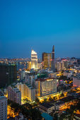 Ho Chi Minh city aeriel view 2015 with new buildings and five star hotels at colorful lights night downtown riverside — Stock Photo