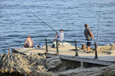 Three men sea fishing — Foto de Stock