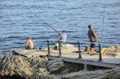 Three men sea fishing — Foto Stock
