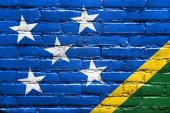 Solomon Islands Flag painted on brick wall — Stock Photo