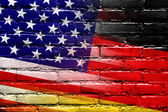USA and Germany Flag painted on brick wall — Stock Photo