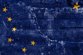 Alaska State Flag painted on grunge wall — Stock Photo
