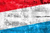 Lucembursko vlajky maloval na zdi grunge — Stock fotografie