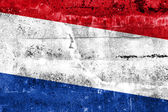 Netherlands Flag painted on grunge wall — Stock Photo