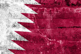 Qatar Flag painted on grunge wall — Stock Photo