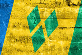 Saint Vincent and The Grenadines Flag painted on grunge wall — Stok fotoğraf