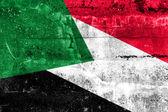 Flaga sudanu namalowane na ścianie grunge — Zdjęcie stockowe