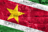 Suriname Flag painted on grunge wall — 图库照片