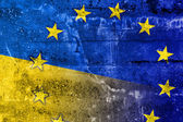 Ukraine and EU Flag painted on grunge wall — Stock Photo