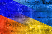 Ukraine and Russia Flag painted on grunge wall — Stock Photo