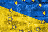 Ukraine and EU Flag painted on grunge wall — Foto Stock