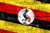 Flaga ugandy namalowane na ścianie grunge — Zdjęcie stockowe