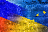 Ukraine, EU and Russia Flag painted on grunge wall — Stock Photo