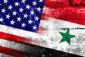 Flaga usa a syrią malowany na ścianie grunge — Zdjęcie stockowe