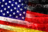 USA and Germany Flag painted on grunge wall — Stok fotoğraf