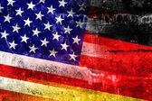 USA and Germany Flag painted on grunge wall — 图库照片