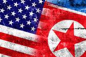 USA and North Korea Flag painted on grunge wall — Stock Photo