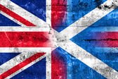 Scotland and United Kingdom Flag painted on grunge wall — Photo