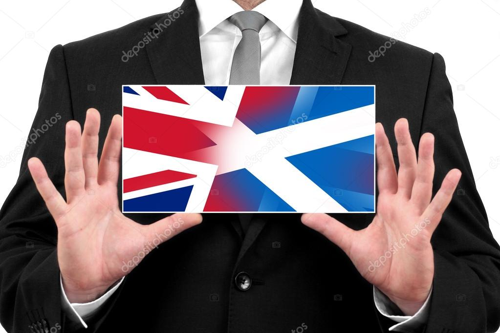 Businessman holding business card with Scotland and United ...