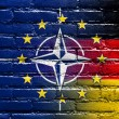 Nato, EU and Germany Flag painted on brick wall — Stock Photo #53771285