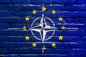 Nato and EU Flag painted on brick wall — Stock fotografie
