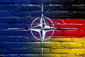 Nato and Germany Flag painted on brick wall — Photo