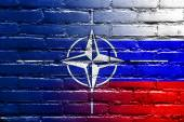 Nato and Russia Flag painted on brick wall — Photo