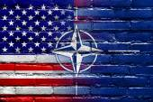 Nato and USA Flag painted on brick wall — Stock fotografie