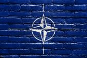 Nato Flag painted on brick wall — Stock fotografie