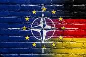 Nato, EU and Germany Flag painted on brick wall — Photo