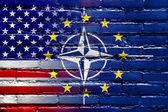 Nato, EU and USA Flag painted on brick wall — Stock Photo