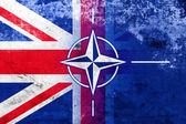 Grunge Nato and UK Flag — Stock Photo