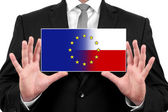 Businessman holding a business card with Poland and European Union Flag — Stock Photo