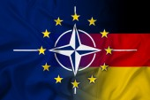Waving Nato, EU and Germany Flag — Photo