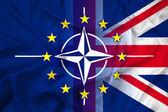 Waving Nato, EU and UK Flag — Photo