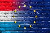 Luxembourg and European Union Flag painted on brick wall — Stock Photo