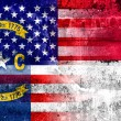 USA and North Carolina State Flag painted on grunge wall — Stock Photo #55304563